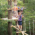 photo of people on ropes course